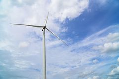 Wind turbines generating electricity on blue sky background .Eco power.  royalty free stock photography