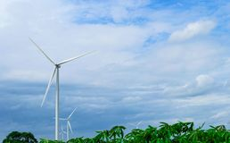 Wind turbines generating electricity on blue sky background .Eco power.  stock images