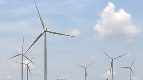 Wind turbines generating electricity stock footage