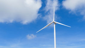 Wind turbines generating electricity with blue sky. Energy conservation concept. White color Wind turbine. Wind turbine on blue sky stock photography