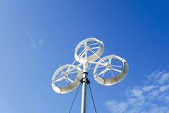 Wind turbines generating electricity with blue sky. Renewable energy source royalty free stock image