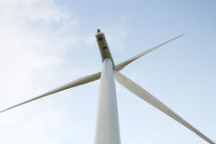 Wind turbines generating electricity. Clouds background stock photos