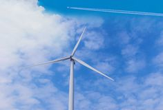 Wind turbines generating electricity farm with the beautiful sky cloud background. The wind turbines generating electricity farm with the beautiful sky cloud stock image