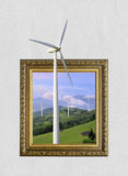 Wind turbines generating electricity in frame with 3d effect. Wind turbines generating electricity in old wooden frame with 3d effect royalty free stock photo