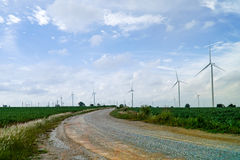 Wind turbines generating electricity with green meadow. Eco power royalty free stock photo