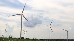 Wind turbines generating electricity stock video