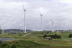 Wind turbines generating electricity, landscape with hills. Wind turbines generating electricity landscape royalty free stock photos