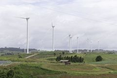 Wind turbines generating electricity, landscape with hills. Wind turbines generating electricity, landscape royalty free stock photos