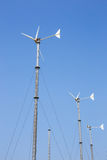 Wind turbines generating electricity on mountain with blue sky at Koh Larn Royalty Free Stock Photo