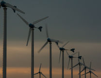 Wind turbines generating electricity. With Sunset Royalty Free Stock Photos
