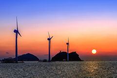 Wind turbines generating electricity at sunset in Korea. Stock Photography