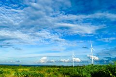 Wind turbines generating electricity. With blue sky in wind farm from Thailand stock image