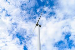Wind turbines generating electricity. With blue sky in wind farm from Thailand stock photography