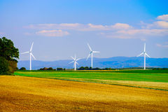 Wind turbines generating electricity in windfarm. Loraine, France royalty free stock photography
