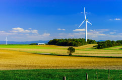 Wind turbines generating electricity in windfarm. Loraine, France royalty free stock image