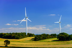 Wind turbines generating electricity in windfarm. Loraine, France stock photos