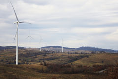 Wind turbines generating green energy Stock Images