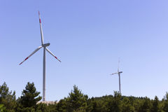 Wind turbines generating renewable wind energy. Wind turbine with blue sky - renewable energy Stock Photography