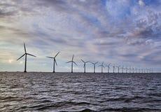 Wind turbines generator farm for renewable sustainable and alter. Native energy production along coast baltic sea near Denmark. Eco power, ecology Royalty Free Stock Photo