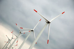 Wind turbines on gloomy sky Royalty Free Stock Photography