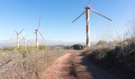 Wind turbines on Golan Heights of Israel. Green power from wind in middle east Stock Photography