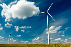 Wind Turbines on gold field with blue sky Stock Images