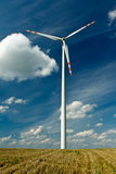 Wind Turbines on gold field with blue sky Royalty Free Stock Photos