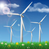 Wind turbines on a grass field Stock Images
