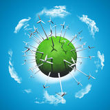 Wind turbines on a grassy globe Royalty Free Stock Photos