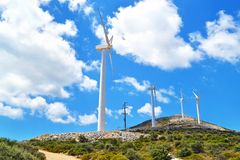 Wind turbines at a greek mountain Stock Photos