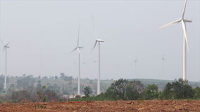 Wind turbines for green energy concept, taken on a cloudy day with dust environment. Wind turbines for green energy concept , taken on a cloudy day with dust stock footage