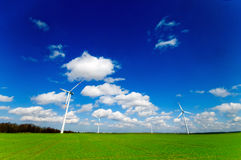 Wind turbines on green field royalty free stock images
