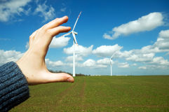 Wind turbines on green field Stock Images