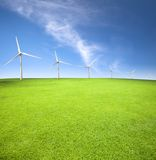 Wind turbines in an green field Stock Images