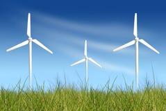 Wind turbines on green field Stock Photos