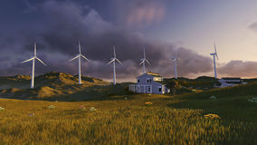 Wind turbines on a green field Stock Photos