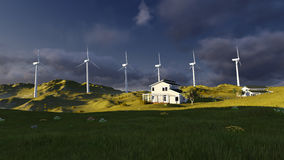 Wind turbines on a green field Stock Photo
