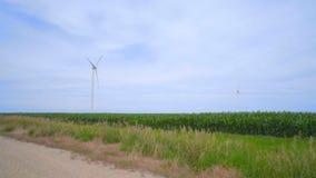 Wind turbines on green field over clouds sky. Alternative energy production. Wind turbines landscape. Renewable energy technology. Wind turbines farm. Wind stock footage