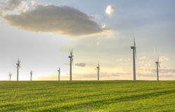 Wind turbines in green field sunset images Royalty Free Stock Image