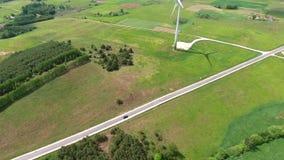 Wind turbines in green fields. Wind turbines in green meadows stock video footage