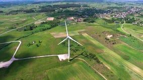 Wind turbines in green fields. Wind turbines in green meadows stock video