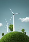 Wind Turbines on green fields and shiny blue skies -  Green Ener Royalty Free Stock Photo