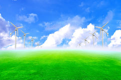 Wind turbines and green grass. Alternative beautiful blade blue cloud cloudy electricity stock image
