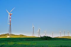 Wind turbines on green grass Stock Image