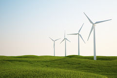 Wind turbines on green grass field Stock Image