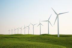 Wind turbines on green grass field Royalty Free Stock Photos