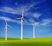 Wind turbines in the green hills Royalty Free Stock Image