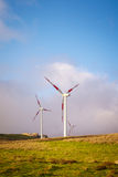 Wind turbines. Green hills with a line of wind turbines Stock Photography