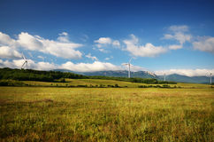 Wind turbines on green meadow Royalty Free Stock Photos