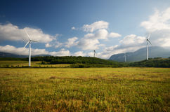 Wind turbines on green meadow Stock Photos